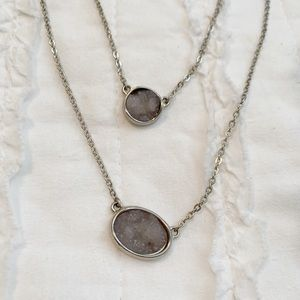 Silver stacked necklace.
